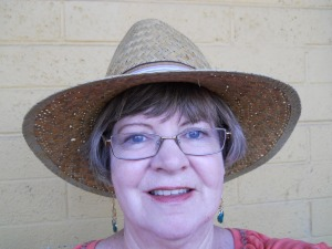 Self-portrait in straw hat.